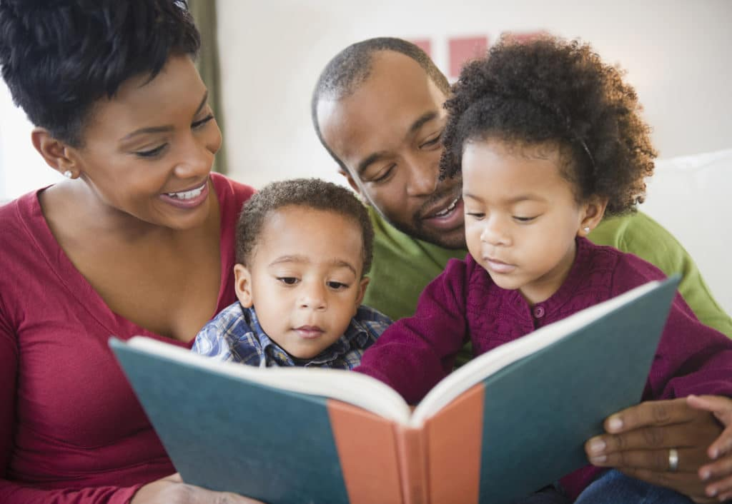 whole family reading a book together