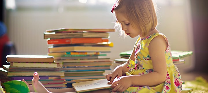 young girl child reading book books