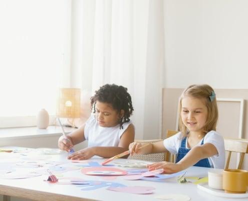 two kids doing artwork