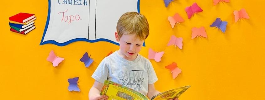 a toddler reading a book