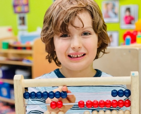 preschooler using an abacus