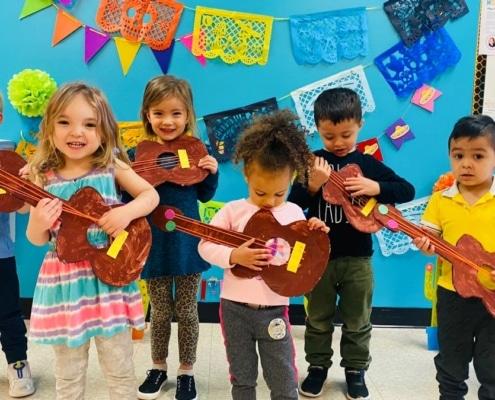 preschool kids playing mexican guitar